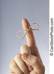 Remember! - A Manila hemp thread bound around an index...