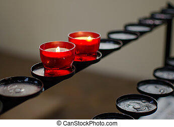 Remember - Close-up of two red candles in a church