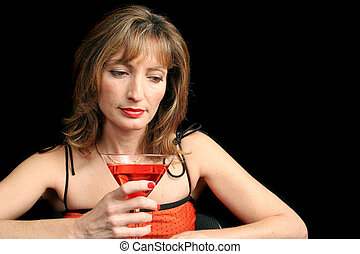 Remembering - A beautiful woman drinking a cocktail and...