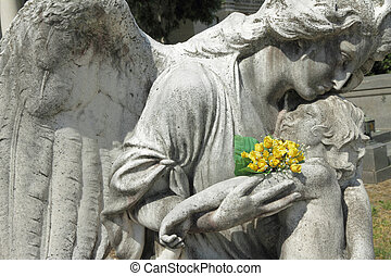 angel holding a child, antique sculpture on Monumental Cemetery of Staglieno, Genoa, Italy, Europe