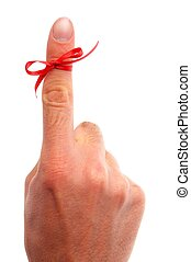 reminder concept with hand and red bow isolated on white...
