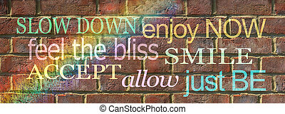 Reminder to slow down, enjoy now, feel the bliss, smile, accept, allow and just be brick wall graffiti