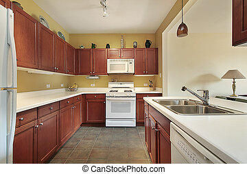 Remodeled wood kitchen with island leading to family room