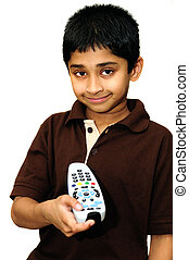 Remote - An handsome Indian kid holding a remote control