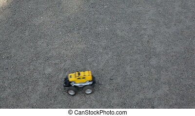 Remote control car or electric car drivers in a circle. -...