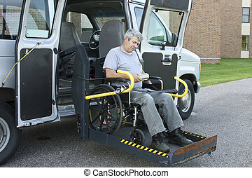 remote control lift van - disabled man operating the remote...
