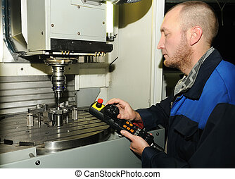 remote control of the milling machine - Operator of the CNC...