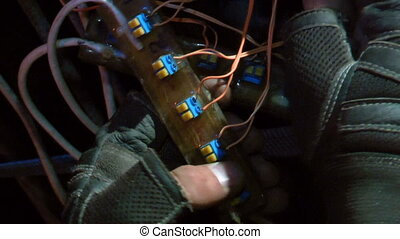 Remote control - A man fixing remote control on a...