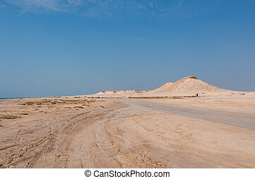 Remote empty sand filled desert in Zekreet- Qatar middle east