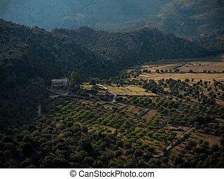 Remote rural countryside landscape rustic farm plantation agriculture field at Santuari de Lluc monastery Mallorca Spain