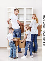 Removal - Family with cardboard boxes indoors
