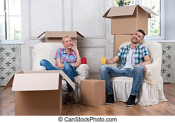 Removal is not easy thing - Happy smiling young couple...