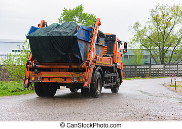 Removal of urban garbage - Specialized car removes waste ...