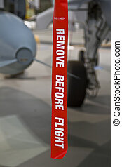 Remove before flight sign