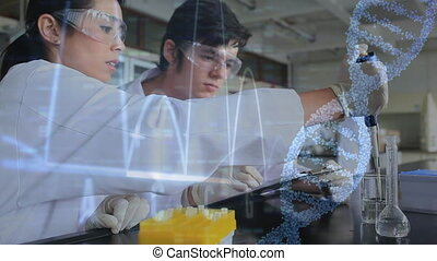Remove - Close up of male and female Caucasian scientists ...