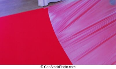Remove film from red carpet - At the banquet with red track...