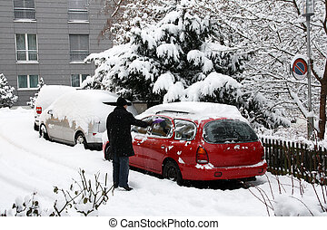 Remove snow from car in a winter morning