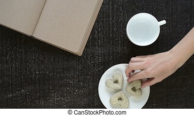 Removing cookies off a plate - Female hand removing cookies...