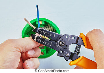 Removing insulation from wires.