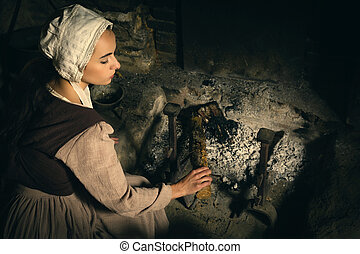 Renaissance woman at fireplace