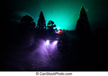 rendőrség autó, vadászrepülőgép, egy, autó, éjjel, noha, köd, háttér., 911, szükségállapot válasz, rendőrség autó, gyorshajtás, fordíts, színhely, közül, crime.