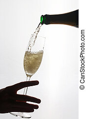 Rendez-Vous - womans hand holding a sparkling wine glass -...