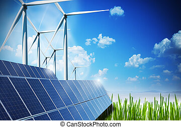 Renewable energy concept with solar panels and wind turbines on green field