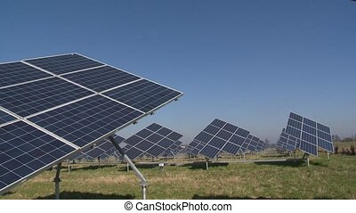 Renewable energy generating solar panels. Rural field full...