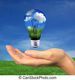 Renewable Energy is Within Reach - Hand Holding Lighbulb...