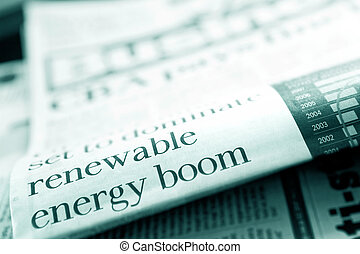 "Newspaper headline reading ""renewable energy boom"". Shallow depth of field, blue tone."