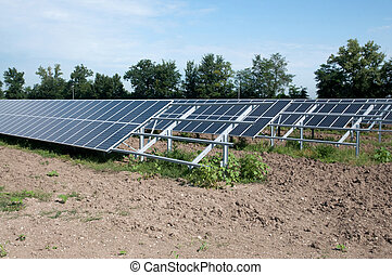 Renewable energy: solar panels in a field. A solar panel (...