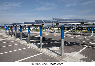 Renewable energy: solar panels in a parking lot of a highway...