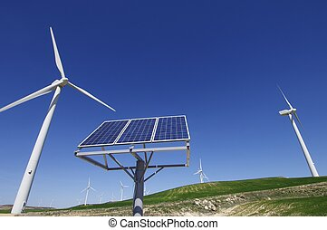 renewable energy - windmill and solar panel with a clear...