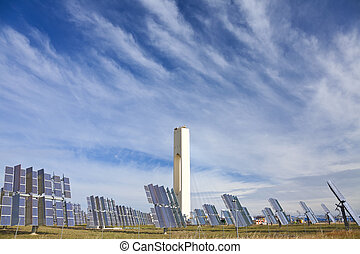 Solar tower surrounded by mirror panels harnessing the sun's rays to provide alternative renewable green energy. Situted in Adalucia, Spain, just outside Seville.