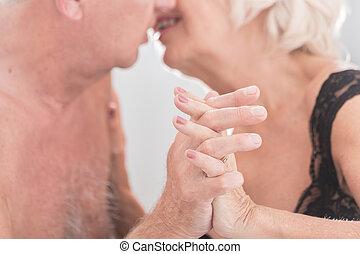Renewal of a vigor - Closeup shot of a mature lovers kissing...