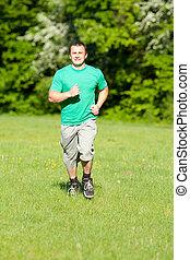 rennender , junger mann