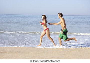 rennender , sandstrand, paar, junger