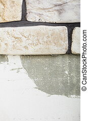 Renovation at home wall clinker tile glue