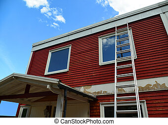 Renovation Of A Red Wooden House Facade