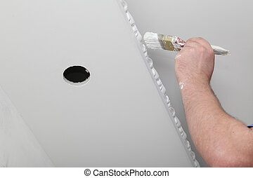 Renovation of house interior. Brush