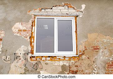 renovation plastic window old brick house wall