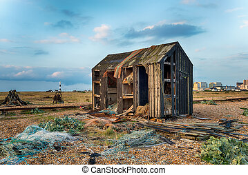 An abandoned fisherman's hut fallen into ruin and disrepair on Dungeness beach in Kent