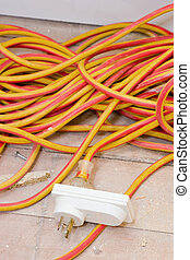 Renovations - Power Cord - A powercord and an adaptor on a ...
