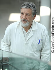 Renowned scientist/doctor in a research center/hospital...