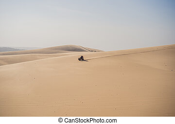 Rent a car for driving on the sand dunes. 4 wheel drive sand car.