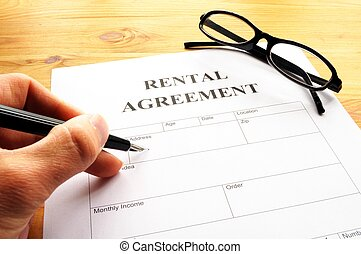 rental agreement form on desktop in business office showing...