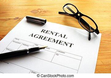rental agreement form on desktop in business office showing...