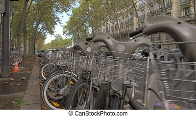 Rental bikes in Paris street, France - Passing by the ...
