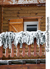Rental chalet covered in snow