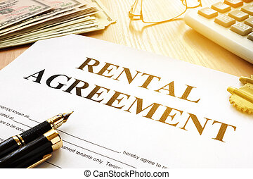 Rental contract on an office desk in the real estate agency.